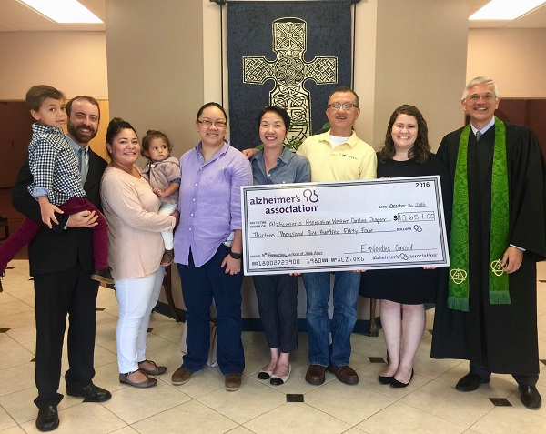 "The check from Enoodles'Tenth Anniversary Fundraiser in honor of Janet Holland Ayers was presented to the Alzheimer's Association. ""Wow, $13,654!!! So thankful for such great friends! Alex and Karenn Wang, thank you for always being there"" - Steve Ayers"